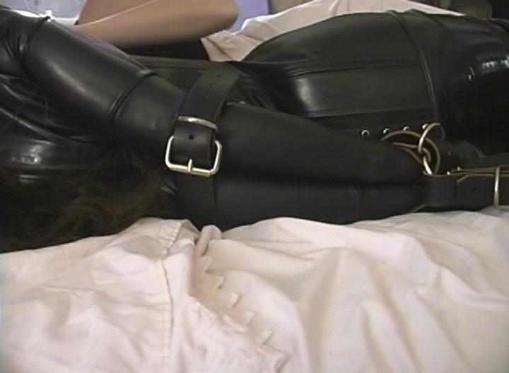 This sexy Dominatrix keeps a slave bound in leather next to her just to keep her company while she sleeps! She likes to keep her bitches all tied up!!