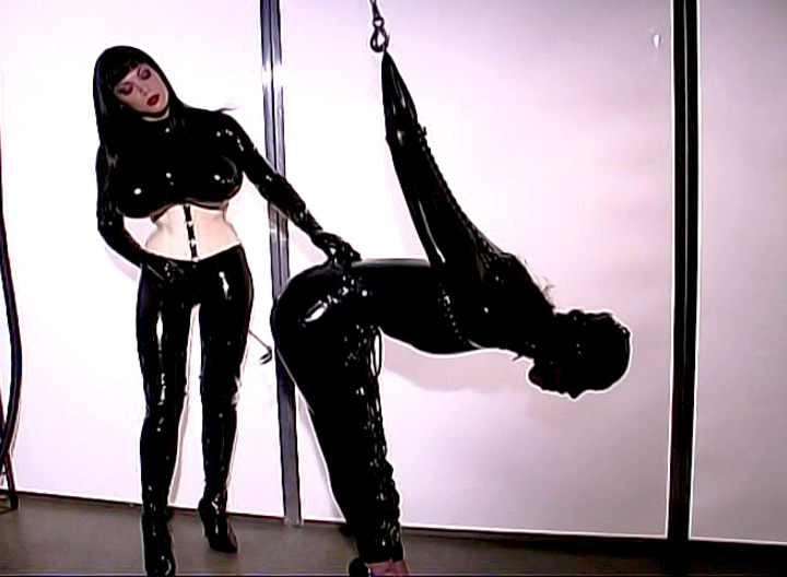 Rubberella has her slave girl bound, and she wrapping her tight.  With a hood over her eyes and her hands ties, this slave has no sense of where her lashings are coming from, just that she deserves them for being so wicked.