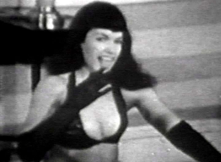 Here's one classic scene of Betty Page. In this scene here she's showing us that she's the Queen of Curves! There is no doubt at all that she truly is!