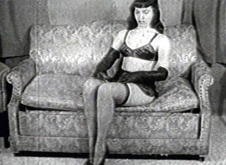 Here's another Betty Page Classic called High Heel Shoes. Legs and feet lovers will be charmed by Betty putting on some stockings and High Heels shoes in the sexiest way ever!