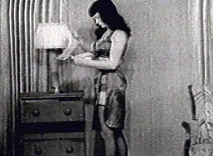 The poor Betty Page gets bound in this vintage scene. Two hot girls get a hold of her and tie her up to a medecine table. What a hot classic this is!