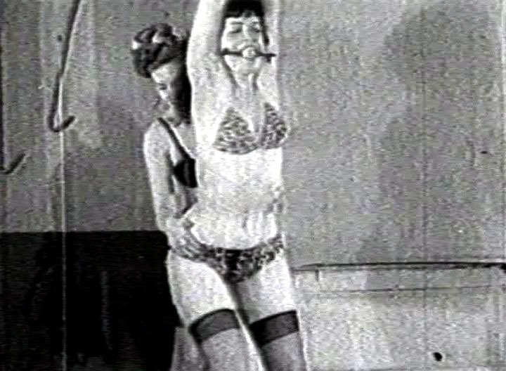 The Tease from Tennessee gets bounded in this classic Betty Page vintage BDSM scene. She's all tied up and gets a gag ball in her pretty mouth.