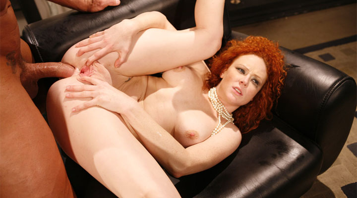 Audrey Hollander is this sexy red head chick who always have something deep inside her ass. Today, it's Lee Stone's big pole stuffing her ass back and forth!