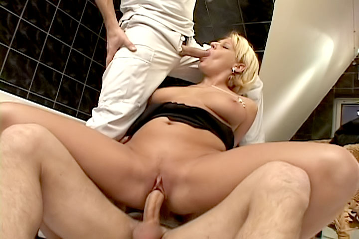 This blonde slut went for a boob scam exam but what she found out was two cocks in erection waiting for her mouth and her pussy!