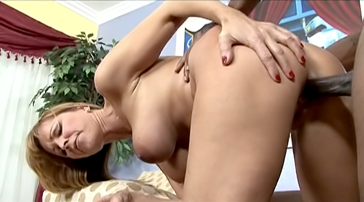 Nicole Moore is a nasty mom who loves to have sex with strangers. This time, it involves a black guy with a huge cock, which she rides and enjoys all of it.