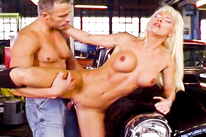 Oldschool action scene in a garage while a woman in the background is doing voyeurism! That whore decided to blow the garage's guy after getting her luxury car repaired!