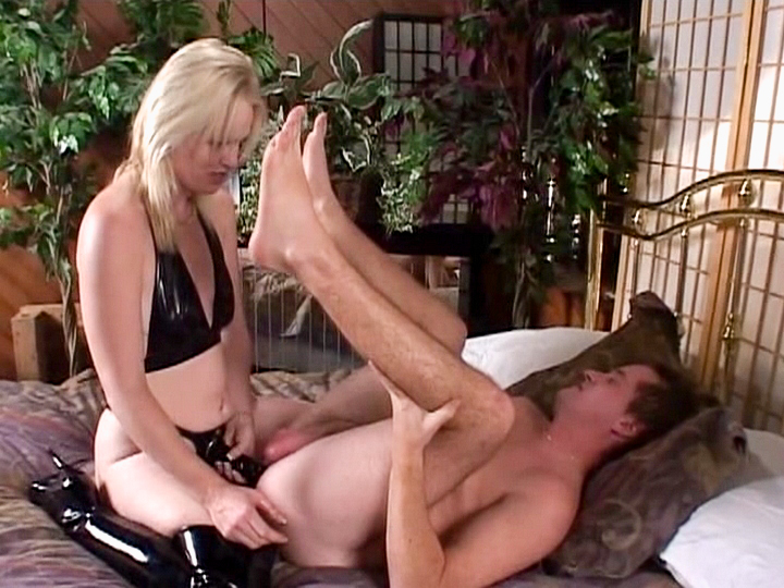 A blonde dominatrix puts back her strap-on to fulfill this lucky guy femdom fantasy